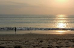 Evening sun  and tourist on golden beach at Kuta Beach Bali Indonesia Royalty Free Stock Photography