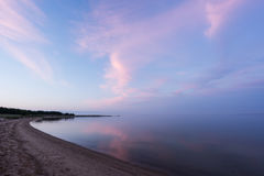 Free Evening Sunlight And Spruce Tree On The Coast, Pink Clouds And Blue Sky Background. Beach In Summer. Seaside Forest. Stock Images - 77701864