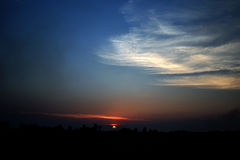 Evening sunlight and the clouds in the countryside of Thailand.  Stock Photography