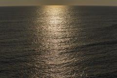 Evening sunlight path over Atlantic Ocean Royalty Free Stock Photography