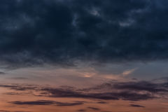 Evening Sunset and Cloudy Blue Red Sky. Use it As a Background. Stock Photo