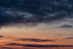Evening Sunset and Cloudy Blue Red Sky. Use it As a Background. Royalty Free Stock Image
