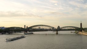 Evening sunset and Hohenzollern Bridge with tanker ships sailing on the River Rhine, Germany. Hohenzollern Bridge And Tanker Ships, Cologne, Germany - July 31 stock footage