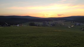 Evening sunset at Jizerka mountain village with small creek in foreground, Czech Republic stock footage