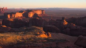 Evening sunset landscape 4k view on red stone mountain cliffs of Monument Valley Navajo Tribal park in Colorado Plateau stock footage