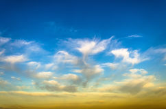Evening sunset light clouds cirrus sky sun texture background.  Royalty Free Stock Images