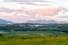The v. Evening and sunset on mountain hills of a romanian village Stock Photo