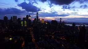 Evening sunset over New York City NYC downtown, amazing skyline with skyscrapers and modern architecture in night lights stock video footage