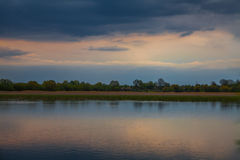Evening sunset over a pond Stock Photography