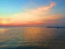 Evening sunset over the waterfront of Rimini. Italy. View from the side of the lighthouse Royalty Free Stock Images