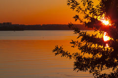 Evening sunset on the river. The picture shows a beautiful sunset on the river Stock Photos