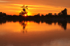 Evening. Sunset on the river. The sun sets behind the horizon Royalty Free Stock Photos