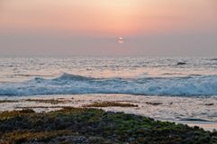 Evening sunset scene at Tanah Lot beach in Bali Royalty Free Stock Image