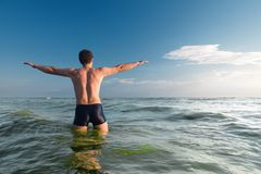Evening swimmer. Man is ready to swim Royalty Free Stock Photography
