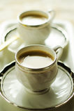 Evening tea. Tea cups with front one focus and the one at far end out of focus royalty free stock photo