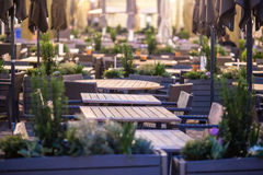 Evening terrace. Outdoor evening terrace of a cafe restaurant with tables and chairs Stock Images