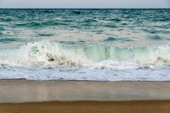 Free Evening Tidal Restless Waves Roll Onto A Sandy Beach Royalty Free Stock Photography - 160454837