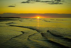 Calm evening tide at sunset. royalty free stock image