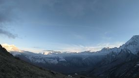Evening time-lapse of a mountain valley with snow-capped mountain peaks during the twilight of a blue hour at a wide. Angle. North Caucasus stock video footage