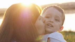 At the evening time before the sunset, baby feeling happy and smiles with her mother in the garden Royalty Free Stock Photo