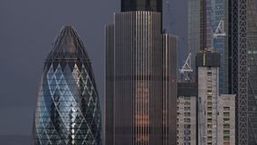 Evening timelapse of London City skyline / Gherkin with dark clouds stock footage