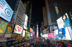 Evening on Times Square NYC. Busy Evening on Times Square New York with dazzling lights and busy crouds Stock Photography