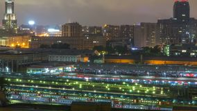 Evening top view of three railway stations night timelapse at the Komsomolskaya square in Moscow, Russia. Aerial view from rooftop. Trains on tracks stock footage