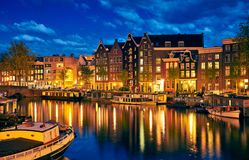 Evening town Amsterdam in Netherlands on bank Royalty Free Stock Images