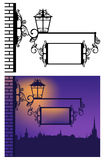 Evening town. Inn or pub sign hanging from a metal pole with lantern - evening scene in old town Stock Images