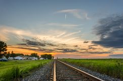 Evening in the town near the railroad tracks, retiring into the Royalty Free Stock Images