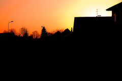 Evening townscape silhouette. Against the sunset sky stock photo