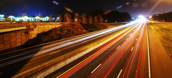 Evening traffic. On highway light trails stock photo