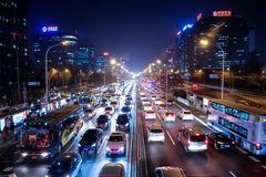 City traffic on modern street in Beijing China. Evening traffic in business district of chinese capital Beijing. Cars are rushing stock images