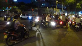 Evening Traffic in Ho Chi Minh City. Traffic in the evening in Ho Chi Minh City, including many Vietnamese motorcycles stock footage