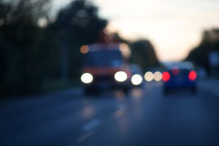 Evening traffic out of focus. Evening traffic on a country road out of focus Royalty Free Stock Photo
