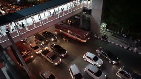 Evening traffic after work rush hour in Bangkok. Transit between sky train and bus at Mo Chit sta. Bangkok, Thailand: October 2015: evening traffic after work stock video