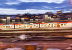 Evening train enters the station with speed in Wiesbaden Stock Photo