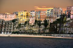 Overhanging houses with overlooking at the seafront in tropea, C royalty free stock images