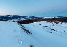 Evening twilight winter mountain ridge panorama Royalty Free Stock Photo