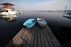 Evening, two boats on the wooden berth Royalty Free Stock Photography