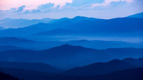 Evening valley with blue mist. In Carpathins Royalty Free Stock Image