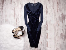 Evening velvet blue dress with chiffon, black shoes Wooden background, space for text. Fashion concept. Royalty Free Stock Photography