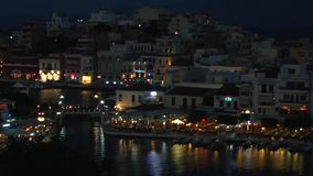 Evening view of Agios Nikolaos city stock footage
