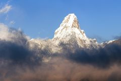 Evening view of Ama Dablam with beautiful clouds royalty free stock photo