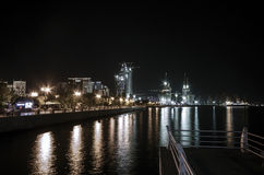 Evening view of Baku. Illuminated skyline of Baku, Azerbaijan at night with lights of buildings reflected in the water. Skyscraper Royalty Free Stock Photo