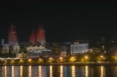 Evening view of Baku. Illuminated skyline of Baku, Azerbaijan at night with lights of buildings reflected in the water. Skyscraper Stock Photos
