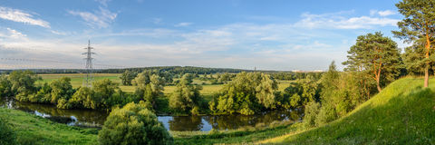Evening view on the bend of the river. Panorame with evening view on the bend of the river Stock Photos