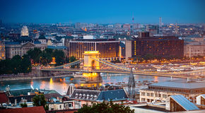 Evening view on bridge and Budapest Royalty Free Stock Image