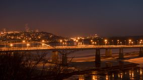 Evening view of bridge over White River in Ufa at winter, Russia, timelapse. stock video