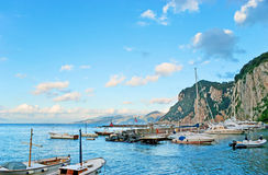 The evening view. CAPRI, ITALY - OCTOBER 3, 2012: The small yachts in port of Marina Grande are the best choise for discovering the coastline, on October 3 in royalty free stock images